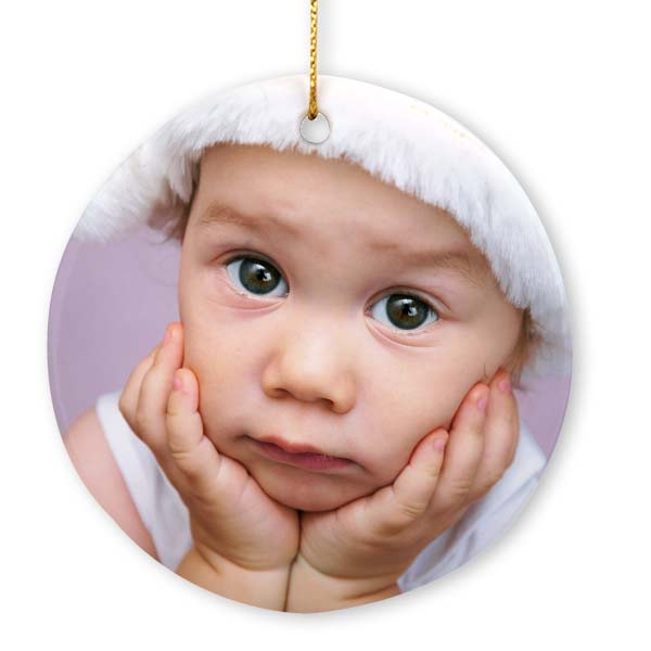 Printed both front and back, our round porcelain photo ornament makes a unique holiday keepsake.