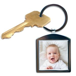 Keep your favorite snapshot close with our personalized silver photo keychain.