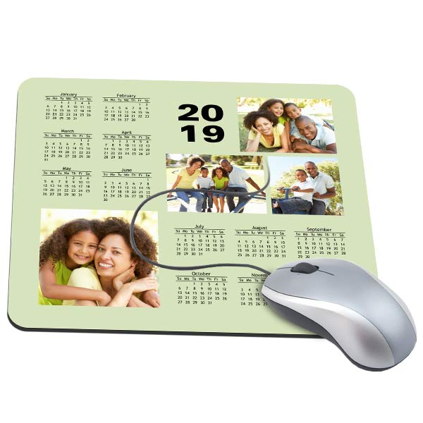 Instantly brighten your desk at work with photos by designing your own calendar photo mouse pad.