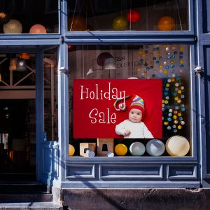 Create a window cling for your store and market in the front window