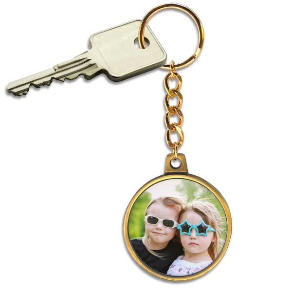 Keep your keys together and safe with an antique gold chain key ring with a picture on it