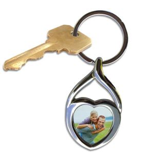 Keep a picture of someone you love close with a personalized heart photo key ring