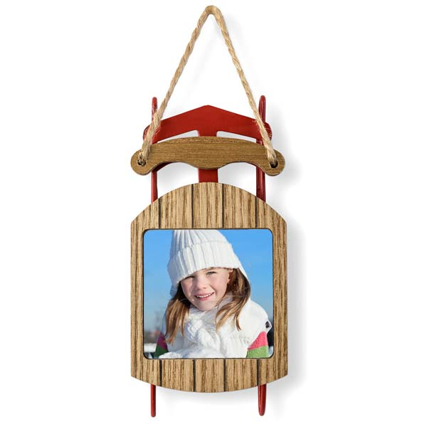 Red metal and wood sled with embedded photo in the wood seat